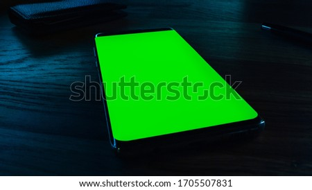 Close-up Macro: Modern Green Mock-up Screen Smartphone Lying on Deks. Chroma Key for Easy Use.