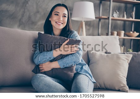 Portrait of her she nice attractive lovely pretty charming cheerful cheery girl sitting on divan alone spending free time in modern loft industrial house apartment flat #1705527598