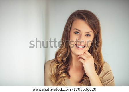 Image of happy young business woman posing isolated over grey wall background. Beautiful female entrepreneur is wearing formals. She is against white background. #1705536820