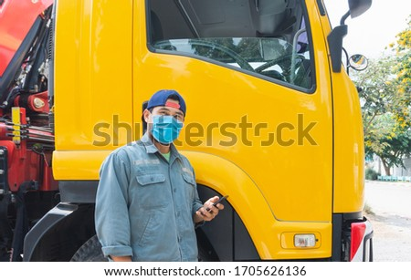 Photos of Asian truck drivers wearing masks to protect against dust and the spread of COVID 19 in front of the car. Safety ideas for a worker in the transportation business. And is a new normal life. #1705626136
