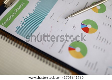 Business chart with silver pen lie on office table closeup background. Buseness education after financial crisis concept #1705641760