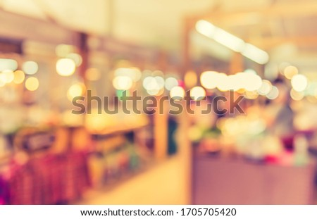 Vintage tone abstract blurred image of  Local indoor day market with bokeh  for background usage. #1705705420