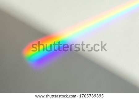 Blurred overlay effect for photo and mockups. Wall texture with organic drop diagonal shadow and rays of light from window on a white wall.