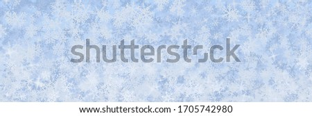Snowflakes falling on a blue background #1705742980