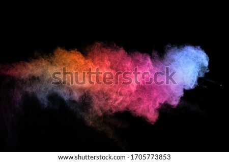 abstract colored dust explosion on a black background.abstract powder splatted background,Freeze motion of color powder exploding/throwing color powder, multicolored glitter texture. #1705773853
