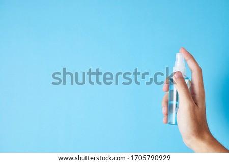 Closeup bottle of blue alcohol hand spray. corona virus concept  #1705790929