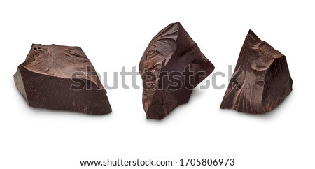 Cracked chocolates / broken chocolate chips or chocolate parts top view isolated on white background including clipping path #1705806973