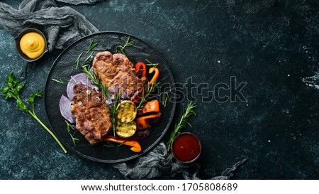 Beef steak. Juicy veal steak with rosemary and spices. Top view. Barbecue. #1705808689