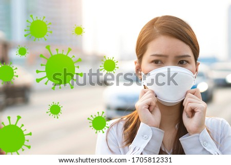 Air pollution and Virus spreading concept, Young woman wearing mask to prevent toxic and virus in city #1705812331