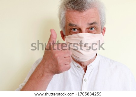 The man puts on a face mask because of the coronavirus epidemic. #1705834255