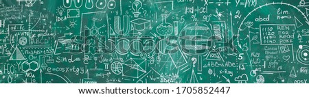 School chalk board is painted with different formulas and signs from the school curriculum. A green blackboard is drawn in chalk as a background. The concept of knowledge and learning. long banner. #1705852447