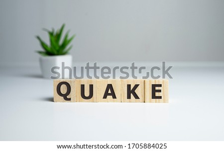Cubes form the word quake. disasters concept Royalty-Free Stock Photo #1705884025