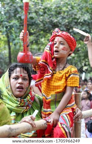 A young adult in traditional style of Baul at Boishakh Celebrations At Chayanot Borsoboron at Ramna Botmul, Dhaka, Bangladesh on April 14, 2014. #1705966249