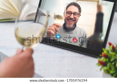 Best friends drinking and toasting online on a video call during the quarantine lockdown. Stay safe at home lifestyle concept. #1705976194
