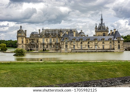 External view of famous Chateau de Chantilly (1560) - historic chateau located in town of Chantilly. Oise, Picardie, France. #1705982125