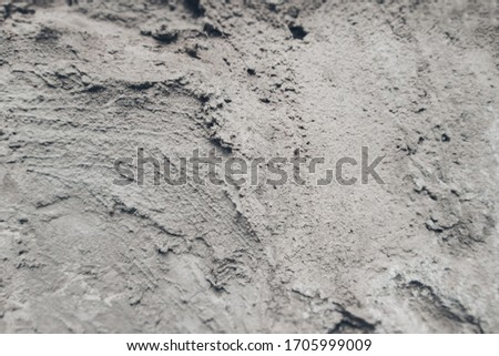 Texture of concrete mortar and sand. Paste-like monochrome mixture with grit. Textured background for decoration and design. #1705999009