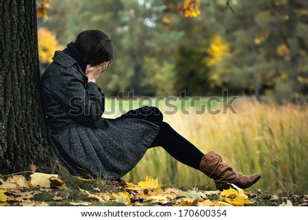 Young woman having autumn depression and crying Royalty-Free Stock Photo #170600354