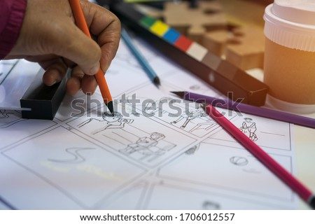 Work stay at home, Director handwriting film storyboard or shooting board, Screenplay, dialog picture for film with characters, Scripted sequence, predefined series of event, pre-production media