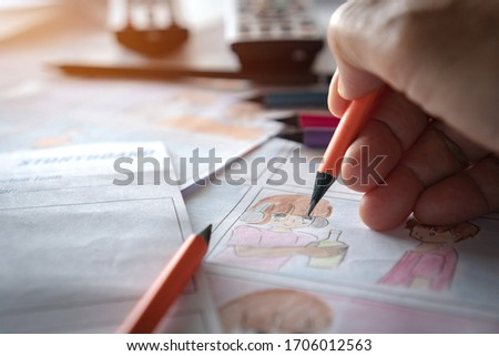 Designer or creative discussion in drawing storyboard for film movie,Video Pre-production process media films in form display script production. Business of media clip, design shot layout in studio