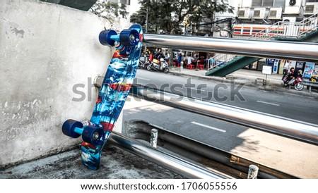 Penny Skateboard Leaning on the Handrail in Bangkok, Thailand #1706055556