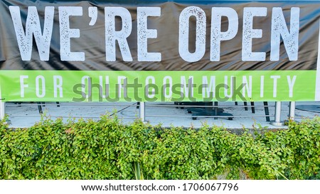 We Are Open Sign Restaurant Take Out Banner during Coronavirus Pandemic Shelter in Place