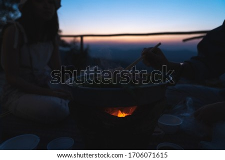silhouette picture . BBQ party on hill