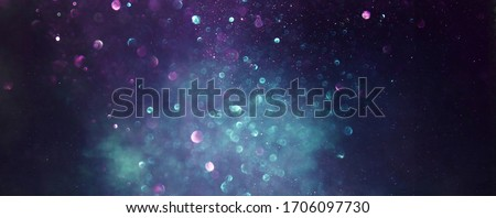 background of abstract glitter lights. gold, blue and black. de focused Royalty-Free Stock Photo #1706097730