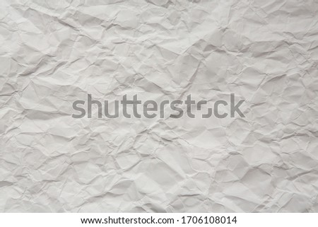 crumpled white wrapping paper, texture Royalty-Free Stock Photo #1706108014