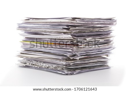 Large pile of waste paper isolated on white. Ready for recycling Royalty-Free Stock Photo #1706121643