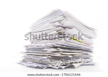 Large pile of waste paper isolated on white. Ready for recycling Royalty-Free Stock Photo #1706121646