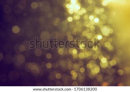 Gold bokeh blur defocus in black use for backgeound #1706138200