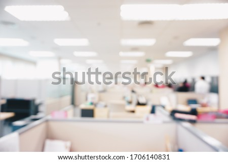 Blurred office interior space background in the workplace with computer shallow depth of focus of abstract background.