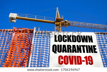 Billboard on the construction site with message LOCKDOWN QUARANTINE COVID-19. COVID-19 alert concept. Lockdown. Concept of stop working activities due to coronavirus medical emergency. #1706196967