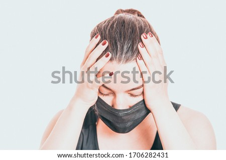 Worried, scare, panicked american woman in medical mask, concerned about viral pandemic illness, paranoid of pandemic. Royalty-Free Stock Photo #1706282431