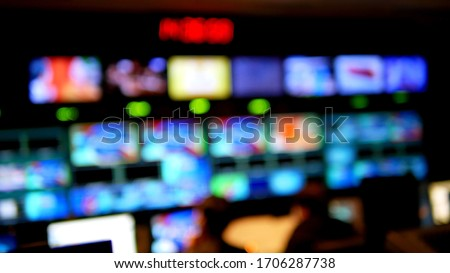 Professional sound engineer's console. Television Broadcast, working with video and audio mixer, control broadcast in recording studio. blurred background, monitors. Royalty-Free Stock Photo #1706287738