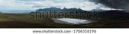 Wonderful view of the rain clouds over the mountains. Dramatic and picturesque scene. Location place Klimentyev Mountain, Crimea, Ukraine, Europe. Artistic picture. Beauty world.