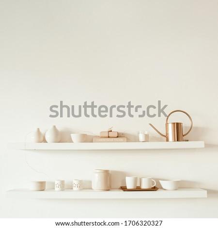Kitchenware utensils on shelf on white background. Mugs, cups, teapot, tray, decorations. Stylish modern kitchen design concept. #1706320327