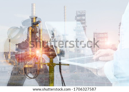 Double Exposure of Welder is Welding business concept on Oil and Gas Refinery Manufacturing Plant Background. #1706327587