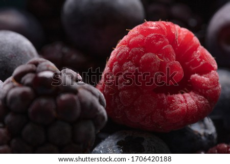 a beautiful close up photograph of fruit, with raspberries, blueberries and blackberries, studio shot