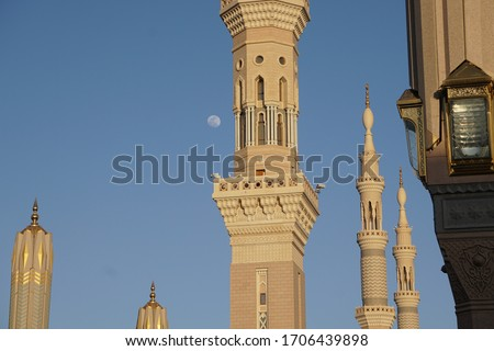 The beautiful tower of nabawi mosque in madina with arabian ornamen  #1706439898