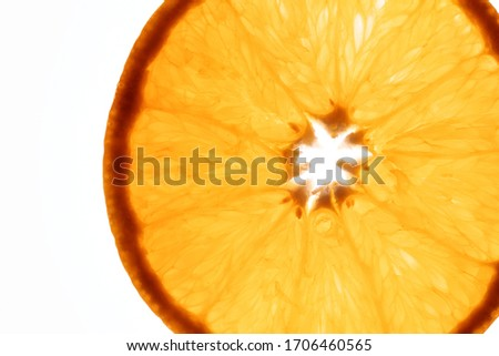 a beautiful close up of an orange slice against a bright white background, flatlay