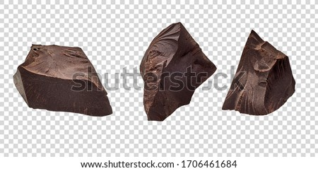 Cracked chocolates / broken chocolate chips or chocolate parts top view on isolated transparent background including clipping path