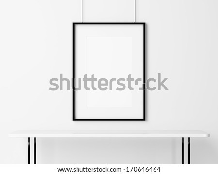 White table and empty picture frame