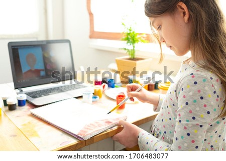 Distance education concept. Covid lockdown. Caucasian girl learns to draw online during self-isolation. #1706483077