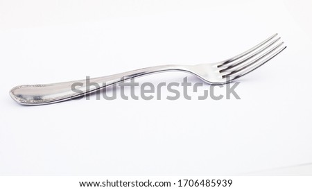 fork isolated on white background. metal fork. vintage fork cutlery side view. #1706485939