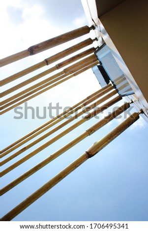 Abstract illustration photos. An iron buffer bridge crossing people with clear skies. photographed from the bottom. Selective Focus #1706495341