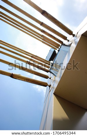 Abstract illustration photos. An iron buffer bridge crossing people with clear skies. photographed from the bottom. Selective Focus #1706495344