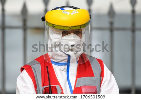 Medical specialist in protective gear stands at entrance of the Kyiv Pechersk Lavra monastery, where multiple cases of the coronavirus disease COVID-19 confirmed. Kyiv, Ukraine, April 2020 #1706501509