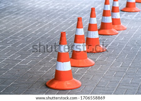 Traffic cones, protective signal plastic orange chips. Road works are carried out in a safe environment. Royalty-Free Stock Photo #1706558869