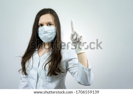 Covid19, coronavirus, girl doctor point finger with idea, wear medical mask to prevent catching virus, white coat. #1706559139